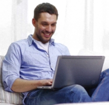 man sitting with a laptop computer