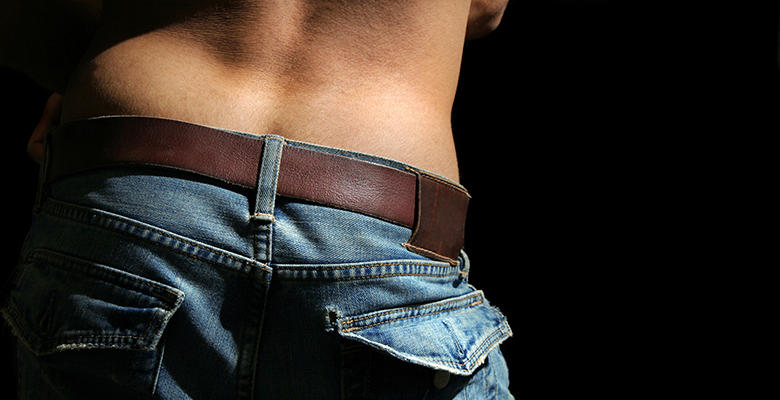 closeup of man in jean from behind